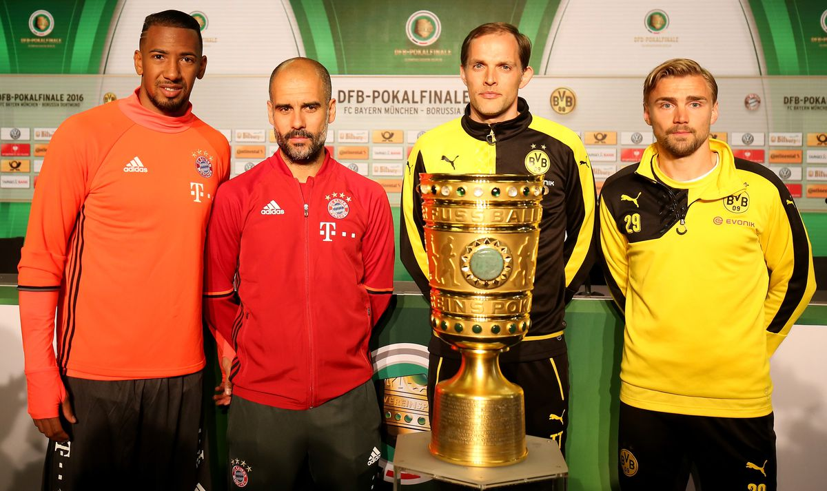Press Conference - DFB Cup Final 2016 BERLIN, GERMANY - MAY 20: Jerome Boateng and head coach Josep Guardiola of Bayern Muenchen and head coach Thomas Tuchel and Marcel Schmelzer of Borussia Dortmund pose with the DFB Cup trophy during the DFB Cup Final 2016 press conference at Olympiastadion on May 20, 2016 in Berlin, Germany