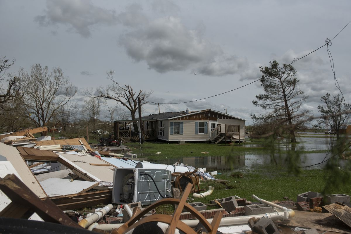 A storm-battered home in Cameron Parish, Louisiana. Debris from the storm is in the foreground of the photo.