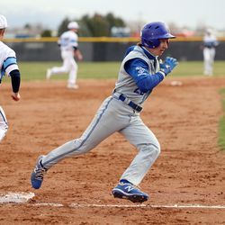 Bingham's Luke Orullian rounds third base on his way into home for a score as Layton and Bingham play a baseball game in Layton on Tuesday, March 23, 2021.