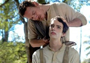 """Silas (Michael Fassbender) gives Jay (Kodi Smit-McPhee) a shave in """"Slow West."""" 