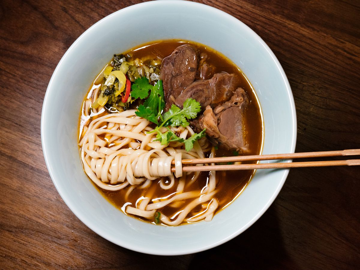 Beef noodles soup, with noodles artfully wrapped around chopsticks, from Ho Foods