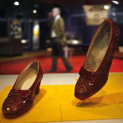 """Dorothy's Ruby Slippers, from the """"Wizard of Oz"""" are seen on display as part of a new exhibit, """"American Stories,"""" at the Smithsonian National Museum of American History in Washington, Wednesday, April 11, 2012. The National Museum of American History will open a new exhibit featuring iconic objects from pop culture along with objects dating back to the Pilgrims' arrival in 1620. """"American Stories"""" will be a new chronology of U.S. history from the first encounters of Europeans and Native Americans to the 2008 presidential election."""