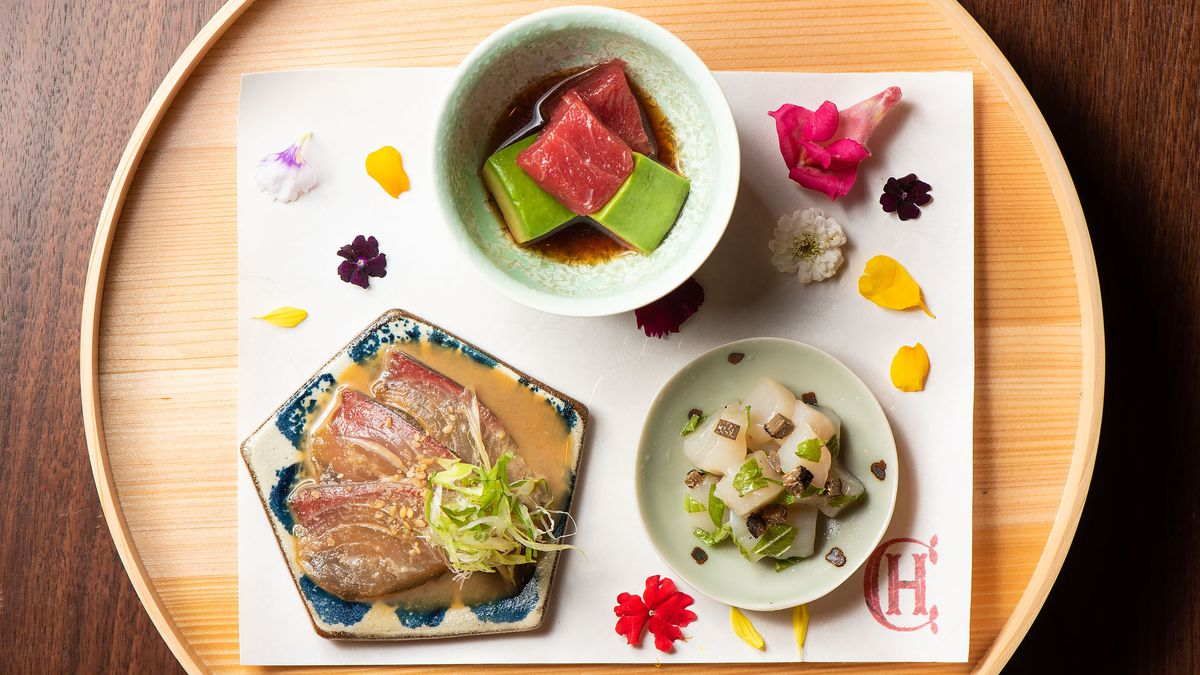 An array of brightly-lit Japanese dishes from Chateau Hanare.