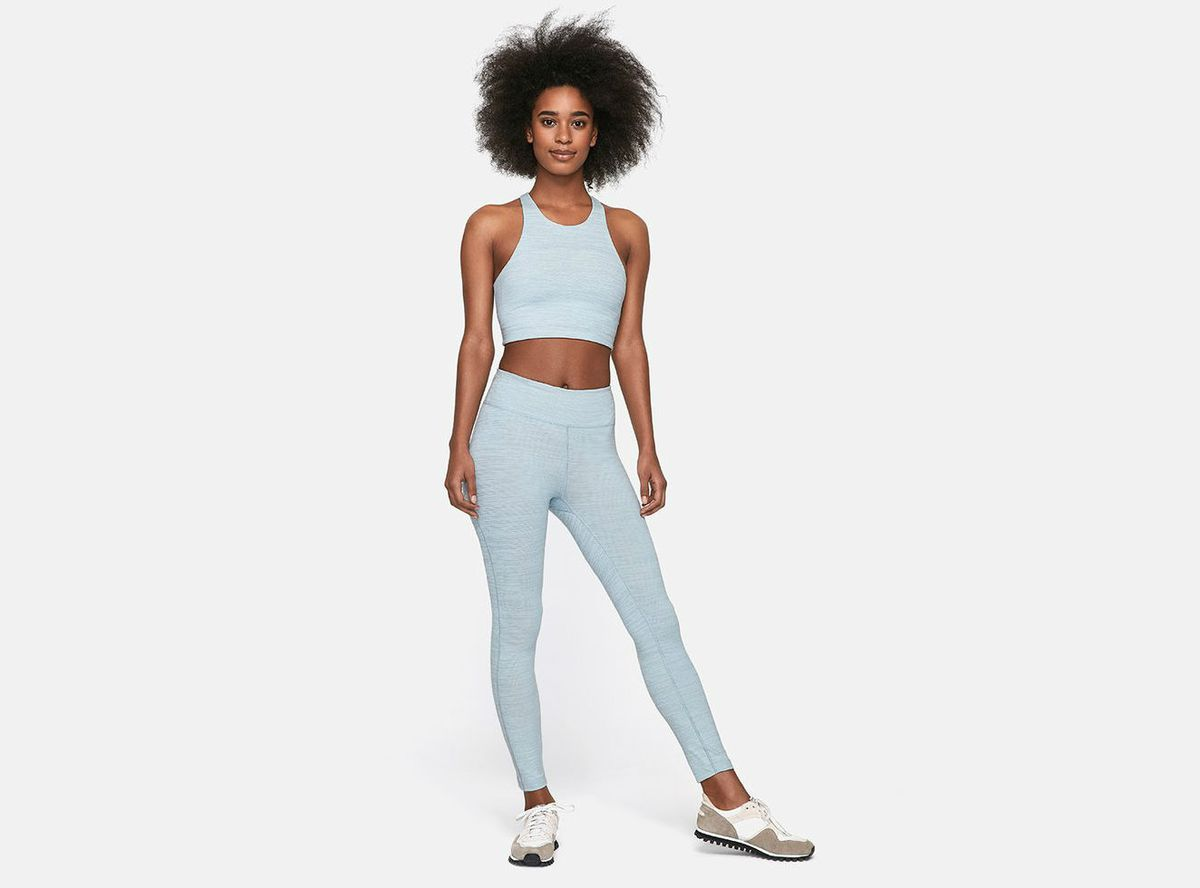 A model in a blue Outdoor Voices bra and leggings