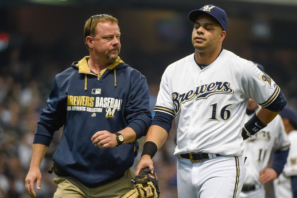 Aramis Ramirez walks off with the trainer after spending too much time thinking about the 2002 Brewers.