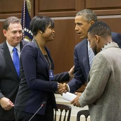 President Barack Obama, greets Brittany Packnett, center, from the Ferguson Committee, following his meeting with elected officials, law enforcement officials and community and faith leaders in the Old Executive Office Building on the White House Complex in Washington, Monday, Dec. 1, 2014. Obama said that in the wake of the shooting of an unarmed 18-year-old man in Ferguson, Missouri, he wants to make sure to build better trust between police and the communities they serve. Also at the meeting are Richard Beary, President of the International Association of Chiefs of Police (IACP) and Phil Agnew, member of the Dream Defenders.