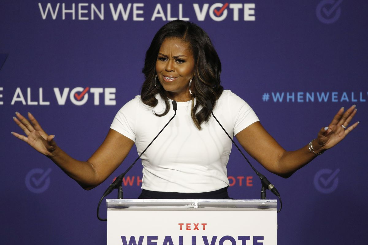 FILE - In this Sept. 23, 2018, file photo former first lady Michelle Obama speaks at a rally to encourage voter registration in Las Vegas. (AP Photo/John Locher, File)