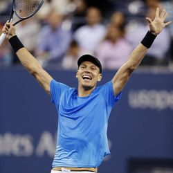 Tomas Berdych, of the Czech Republic, raises his arms after defeating Roger Federer, of Switzerland, in the quarterfinal round of play at the U.S. Open tennis tournament, Wednesday, Sept. 5, 2012. in New York. Berdych won 7-6 (1), 6-4, 3-6, 6-3.