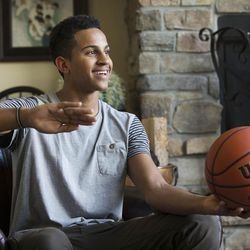 Lone Peak High's Frank Jackson Monday, April 27, 2015, at home in Highland talking with his dad Al.