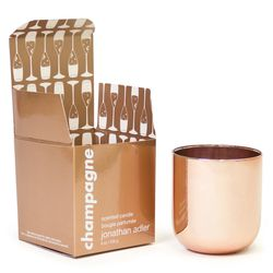 """Not only is this <b>Jonathan Adler Champagne Pop Candle</b> a gorgeous rose gold addition to any room, it smells amazing. With hints of grapefruit, rose, and, of course, champagne, it will bring her apartment to life. Pick it up at <a href =""""http://www.jo"""