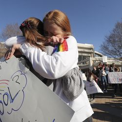 BYU student Caroline McKenzie, right, hugs Danielle Jensen as LBGT supporters rally on Brigham Young University's campus in Provo on Wednesday, March 4, 2020.