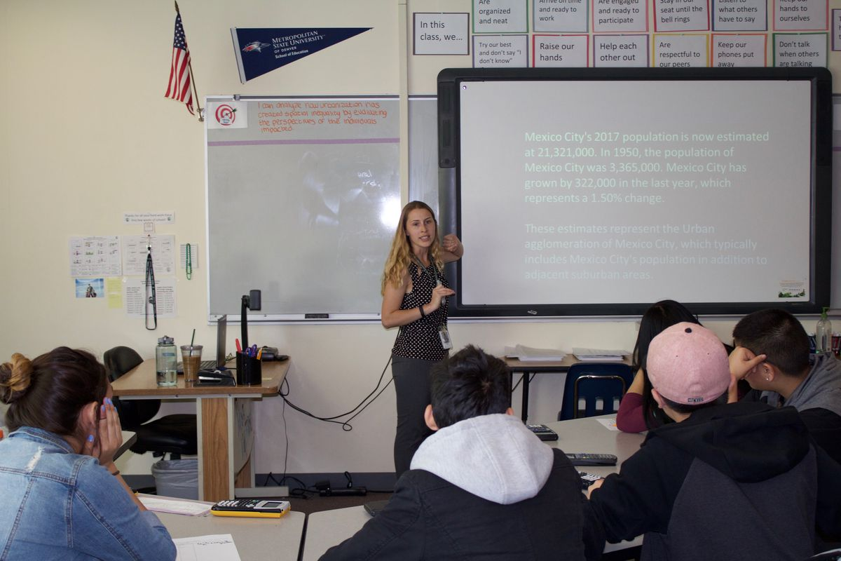 A social studies teacher gives a class to freshman at Aurora Central High School in April 2017. (Photo by Yesenia Robles, Chalkbeat)