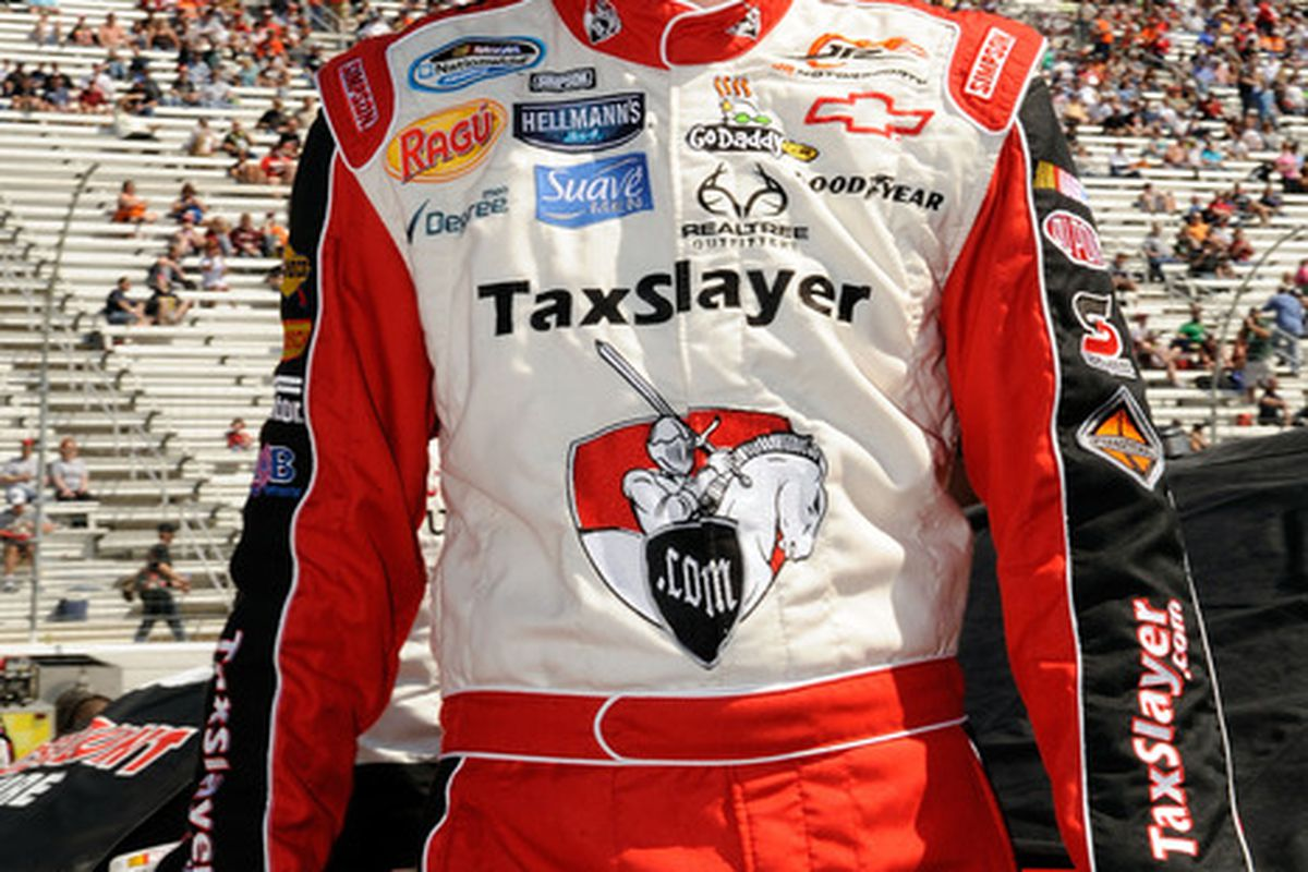 Dale Earnhardt Jr. stands next to his car on the grid prior to the NASCAR Nationwide Series Scotts EZ Seed 300 at Bristol Motor Speedway.