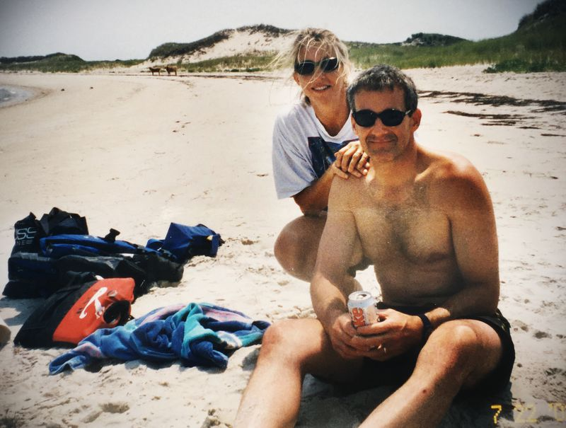 The 2002 photo of Kris Newby and her husband on the beach.