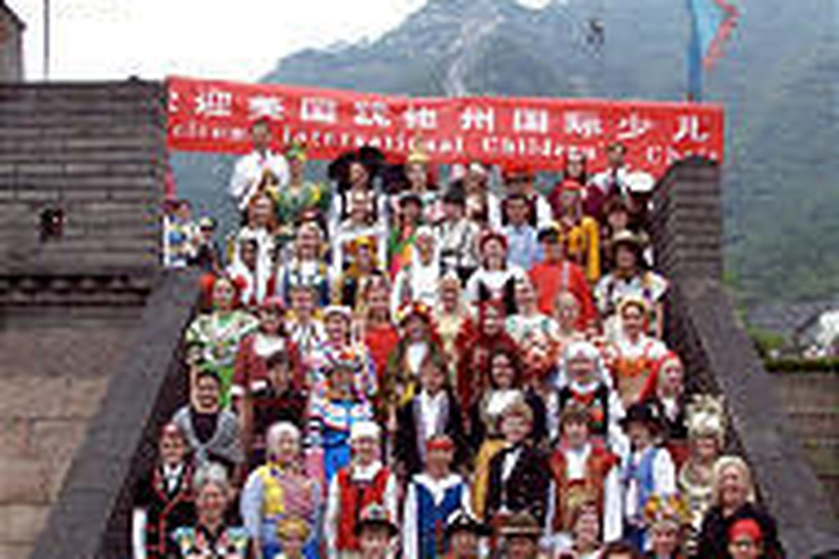The International Children's Choir gathers at the Great Wall of China on Pioneer Day.