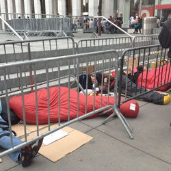Many of the occupiers have matching red sleeping bags.
