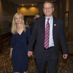 Doug and Cynthia Owens walk to the main hall as he concedes the race for the 4th Congressional District Tuesday, Nov. 4, 2014, in Salt Lake City.