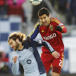 Real's Tony Beltran and Kansas City's Graham Zusi head the ball as Real Salt Lake and Sporting KC play Saturday, Dec. 7, 2013 in MLS Cup action.