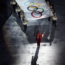 The Olympic flag is carried away during the Salt Lake 2002 Winter Games closing ceremony on Sunday, Feb 24, 2002, at the University of Utah's Rice-Eccles Stadium in Salt Lake City.