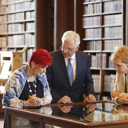 Elder D. Todd Christofferson, of the Quorum of the Twelve Apostles of The Church of Jesus Christ of Latter-day Saints, along with his wife, Sister Katherine Christofferson, gets a tour from Alina Nachescu at the Upper Library at Christ Church, Oxford University, prior to speaking in Oxford, England, on Thursday, June 15, 2017. Some books date back to the 9th century.