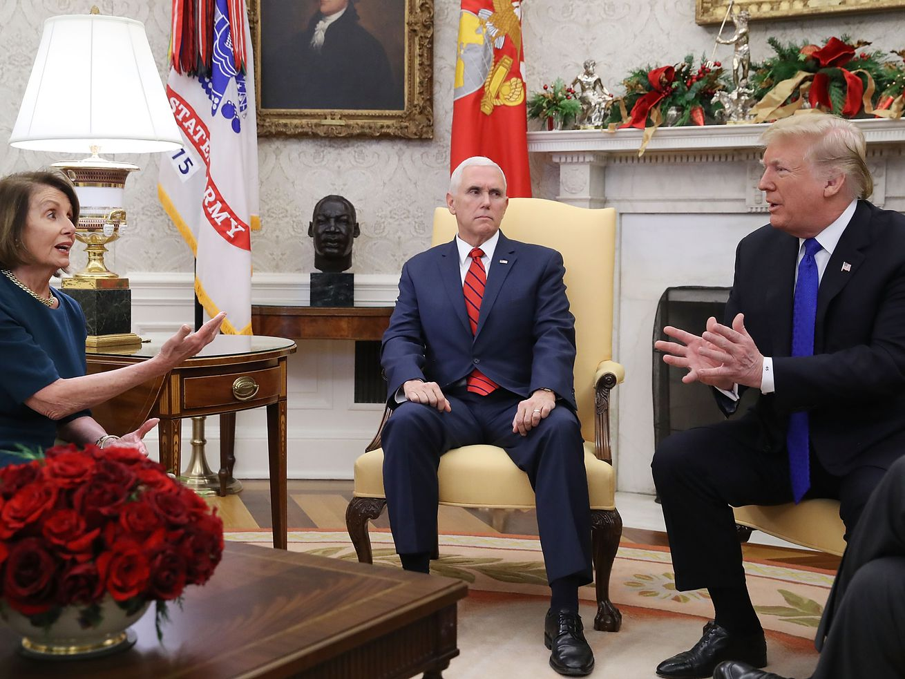 President Donald Trump argues about border security with House Minority Leader Nancy Pelosi as Vice President Mike Pence sits nearby in the Oval Office on December 11, 2018, in Washington, DC.