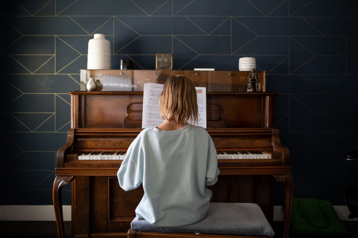 Emery Blackburn, 9, practices piano at her home in South Jordan on Tuesday, Sept. 14, 2021. Emery and her mother, Ashley, have both experienced long-haul symptoms since the family had COVID-19 in July 2020.