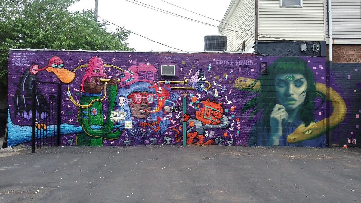 """An outdoor side wall of the Bridgeport restaurant Kimski, 960 W. 31st St., showcases the mural """"Grape Drink"""" — an homage to 1980s and 1990s pop culture done by five artists."""