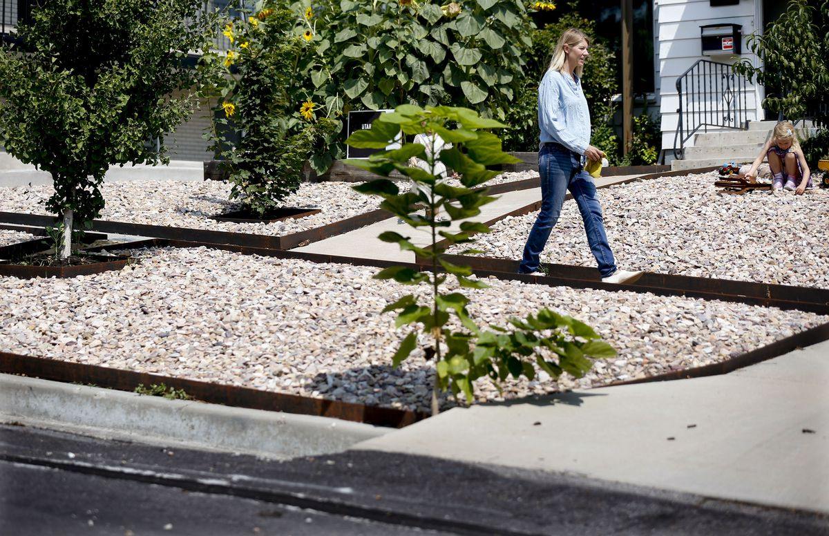 Rachel Simeon walks down the sidewalk at her Salt Lake City home on Friday, Aug. 20, 2021. Simeon was dumbfounded when she got a letter from Salt Lake City code enforcement, in the midst of Utah's super drought, that she needed to add more vegetation to her park strip that would require more water.
