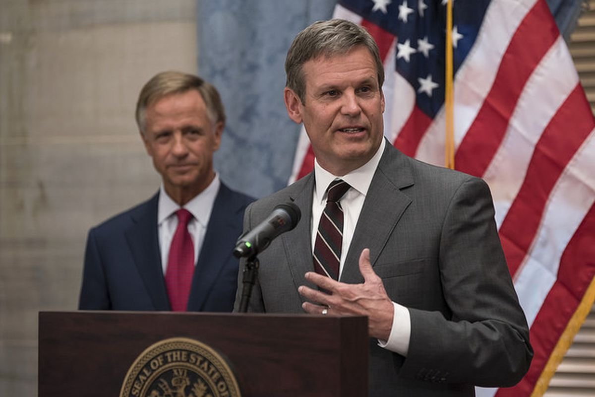 Bill Lee speaks with reporters in November 2018 after his election as Tennessee's 50th governor, as outgoing Gov. Bill Haslam looks on.