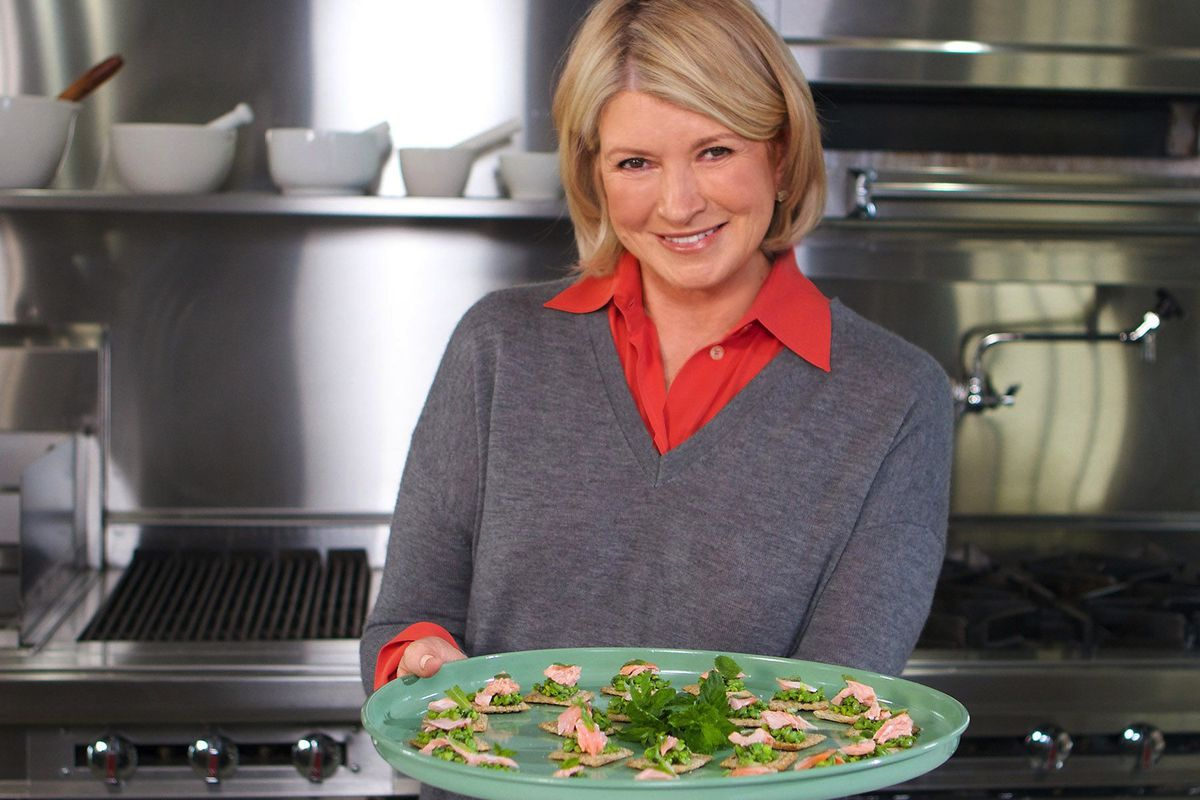 Martha Stewart poses with one of her signature creations.