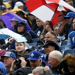 BYU fans endure the rain during the Blue-White game at LaVell Edwards Stadium in Provo on Saturday, April 7, 2018.