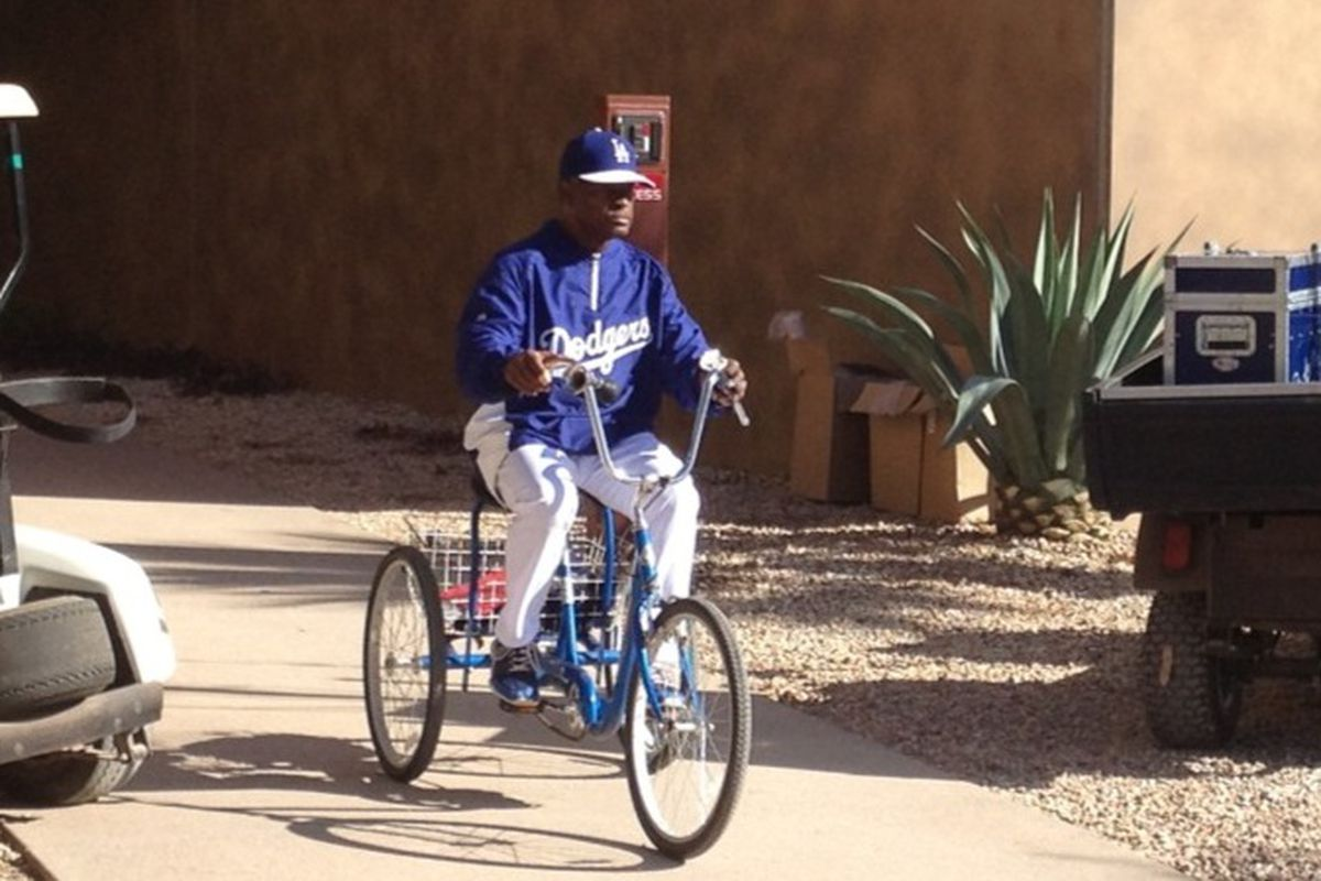 The site of Manny Mota on his tricycle is one of the signs of Dodgers spring training.