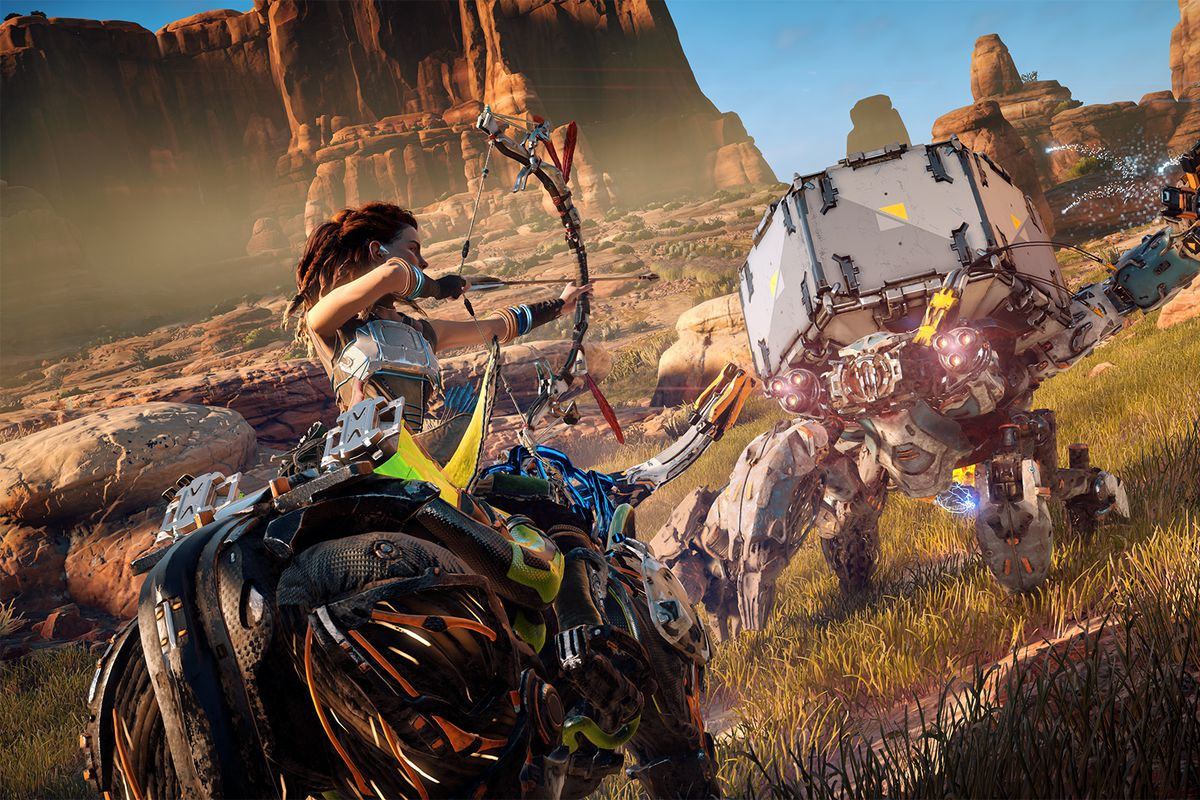 Aloy, a red-haired woman riding a mechanical beast, aims a bow and arrow at a Shell-Walker, a robot with a hexagonal block on its back, in Horizon Zero Daw