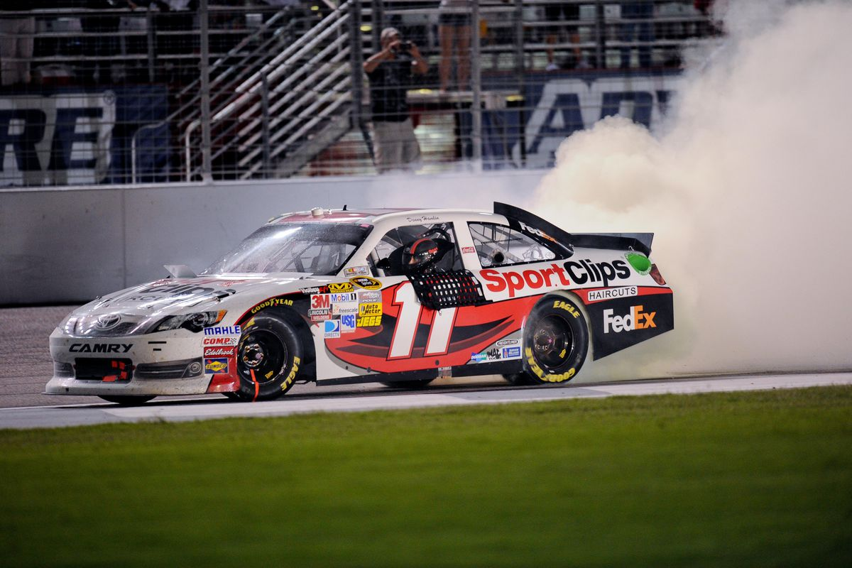 September 02, 2012; Hampton, GA, USA; TNASCAR Sprint Cup Series driver Denny Hamlin (11) celebrates winning the AdvoCare 500 at Atlanta Motor Speedway. Mandatory Credit: Kevin Liles-US PRESSWIRE