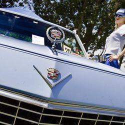A mannequin dressed as a drive-up diner waitress stands next to a 1967 Cadillac Calais coupe during a car show Saturday at Midvale Park in Midvale.  The proceeds from the car show were donated to Shriners Hospital.