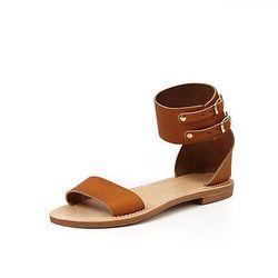 """<a href=""""https://www.stevenalan.com/Mage-Boucle-Cuoio-Sandal/VENSP12_NA_SP12-E2Y07C1,default,pd.html?dwvar_VENSP12__NA__SP12-E2Y07C1_color=TAN#cgid=sample-sale-womens-shoes&start=0&hitcount=33"""">Laura Urbinati x La Botte Gardiane sandal</a>, was $202 now $"""