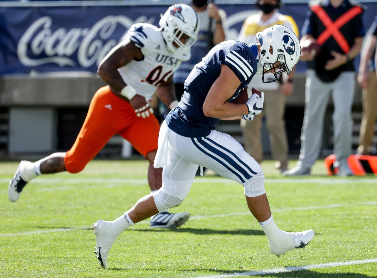 Brigham Young Cougars running back Lopini Katoa (4) runs the ball in for a touchdown, putting the Cougars up 14-3 over the UTSA Roadrunners after the PAT, at LaVell Edwards Stadium in Provo on Saturday, Oct. 10, 2020.