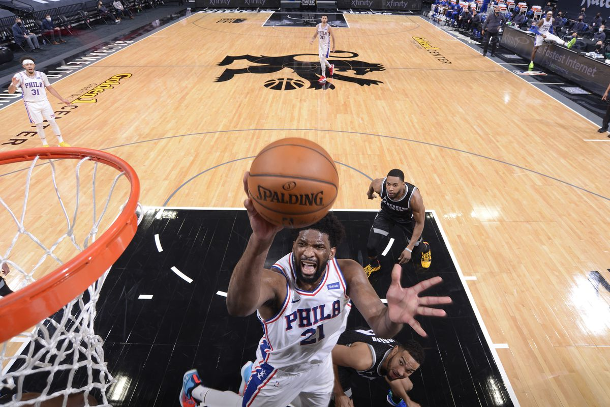 Joel Embiid of the Philadelphia 76ers drives to the basket during the game against the Sacramento Kings on February 9, 2021 at Golden 1 Center in Sacramento, California.