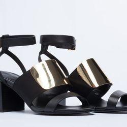 """<b>See By Chloe</b> Black Gold Sandals, <a href=""""http://www.solestruck.com/see-by-chloe-sb22041-black-gold/index.html"""">$360</a>"""