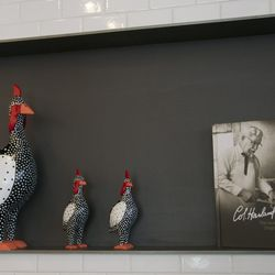 Col. Sanders in book form and three non-edible chickens reside next to the register.