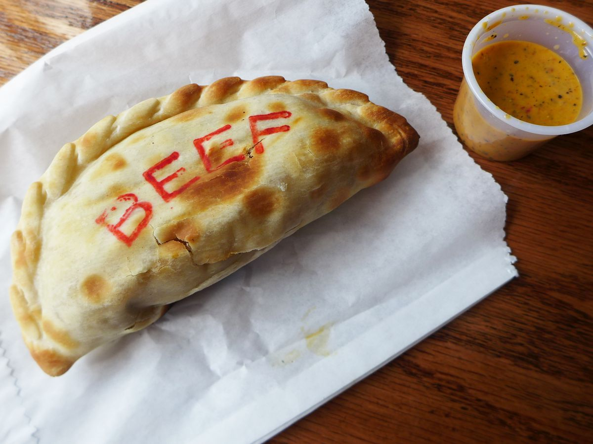 A crescent pie with beef written in block letters along the side.