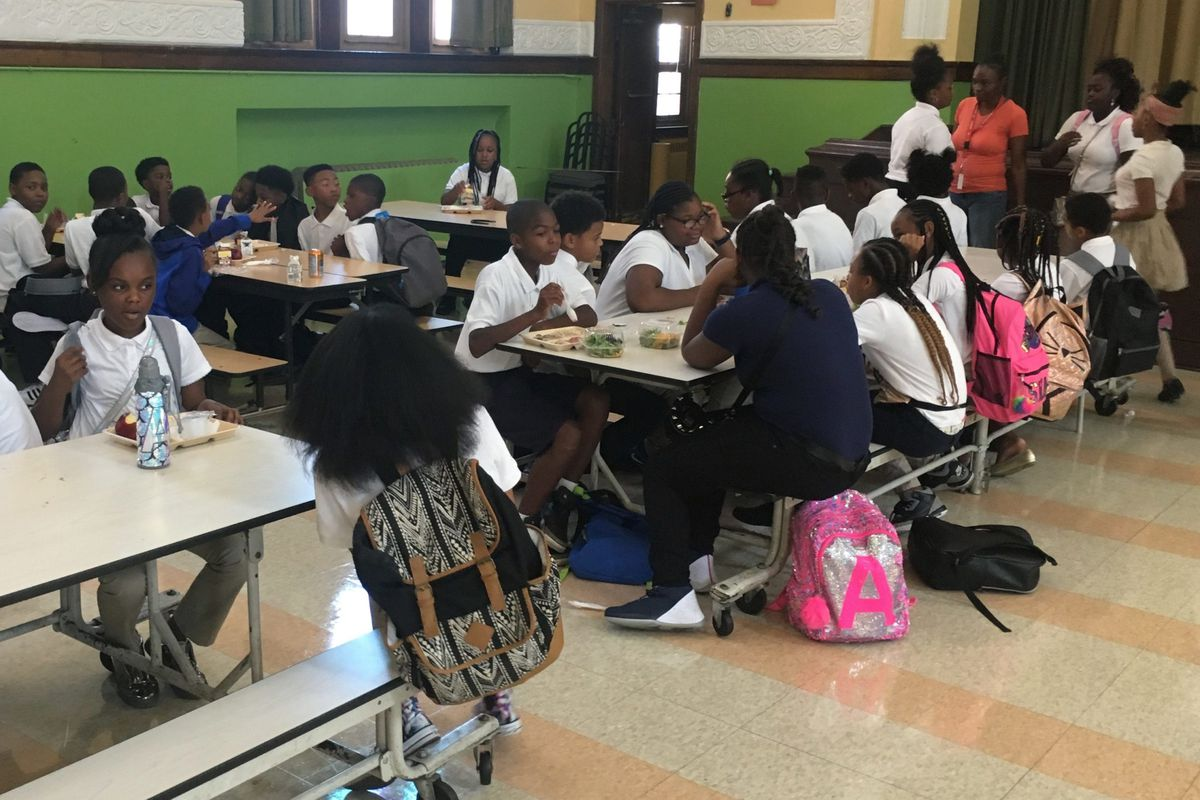 The cafeteria at the Golightly Education Center, above, is full on a normal school day. On Wednesday, the room sat empty because the Detroit district was closed due to an ice storm.