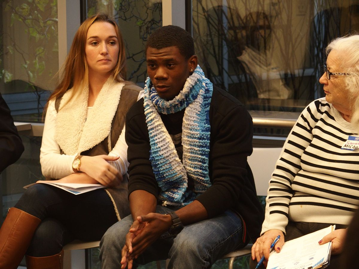 Terrion Anderson, a student at G.W. Carver College and Career Academy shares during a small group discussion at BRIDGES' Youth Action Networking Day on Dec. 15.