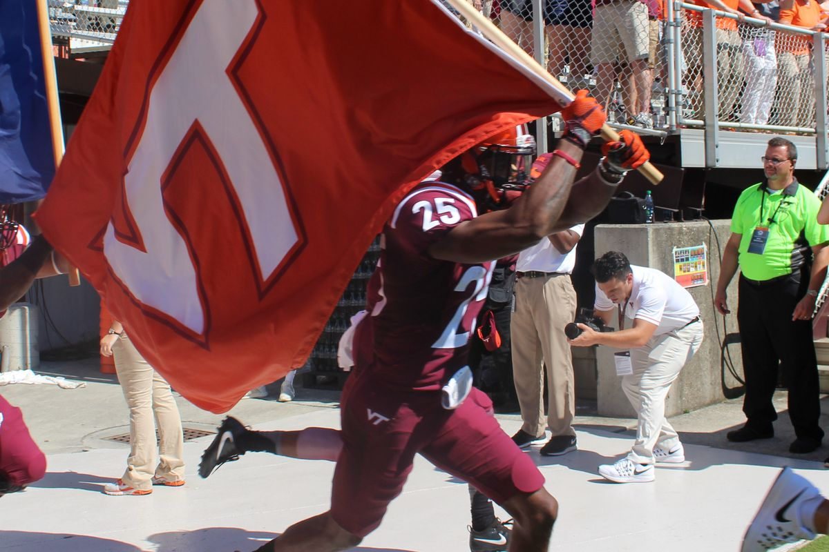 Greg Stroman Carries the VT Flag on to the field