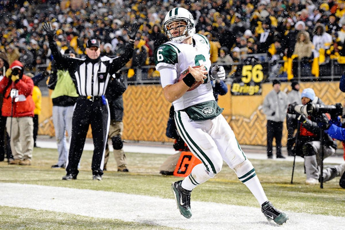 PITTSBURGH PA - DECEMBER 19:  Mark Sanchez of the New York Jets runs for a touchdown during the game against Pittsburgh Steelers at Heinz Field on December 19 2010 in Pittsburgh Pennsylvania. (Photo by Karl Walter/Getty Images)