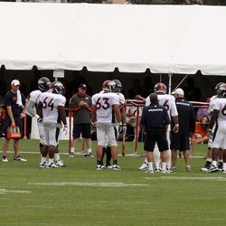 The offensive line gets instructed on the next drill