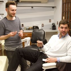 Sharps owner Rory MacParland (seated) with a barber he brought over from England