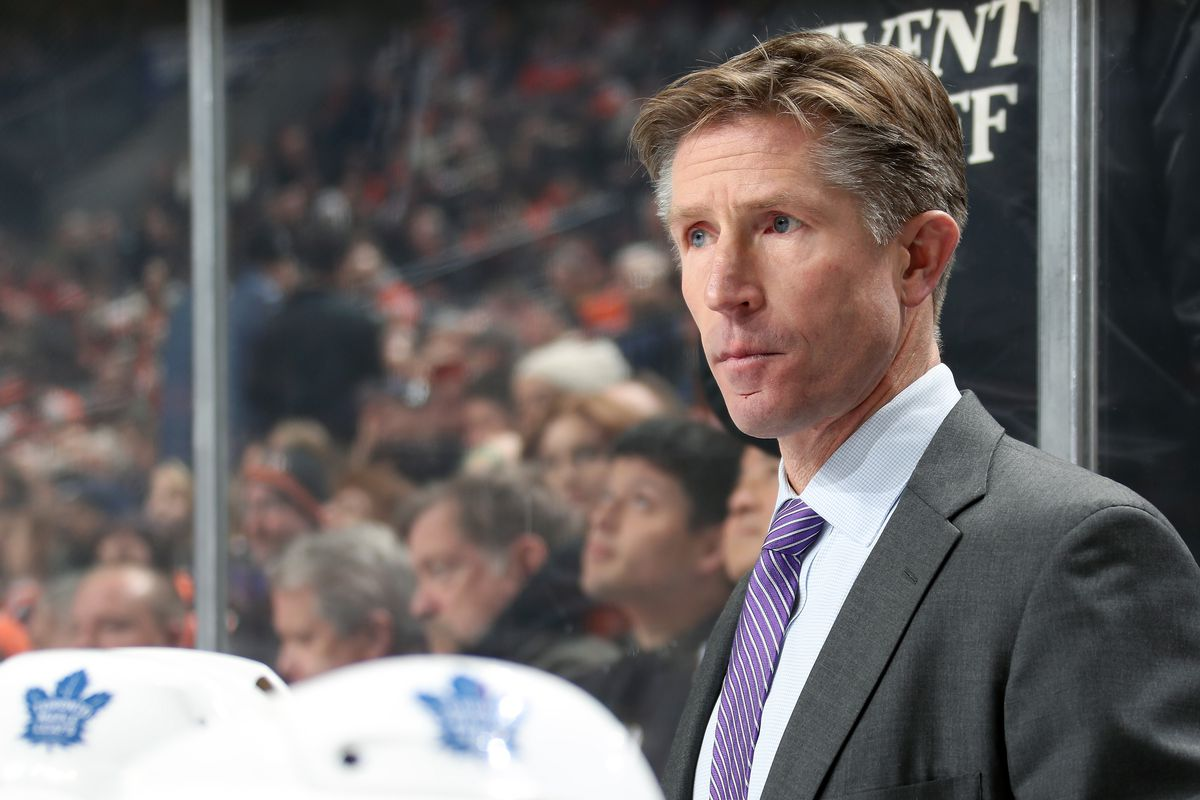 Assistant Coach of the Toronto Maple Leafs Dave Hakstol watches a play develop on the ice against the Philadelphia Flyers on December 3, 2019 at the Wells Fargo Center in Philadelphia, Pennsylvania.
