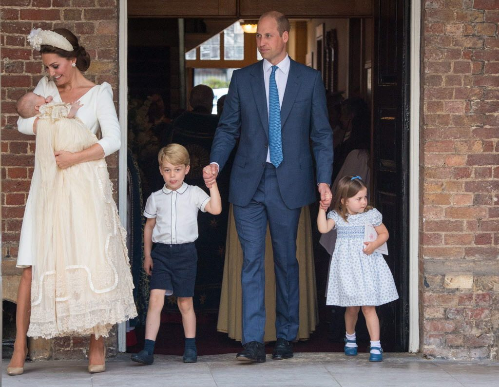 Britain's Princess Charlotte of Cambridge and Britain's Prince George of Cambridge hold hands with their father, Britain's Prince William, Duke of Cambridge, as Britain's Prince Louis of Cambridge is carried by his mother, Britain's Catherine, Duchess of