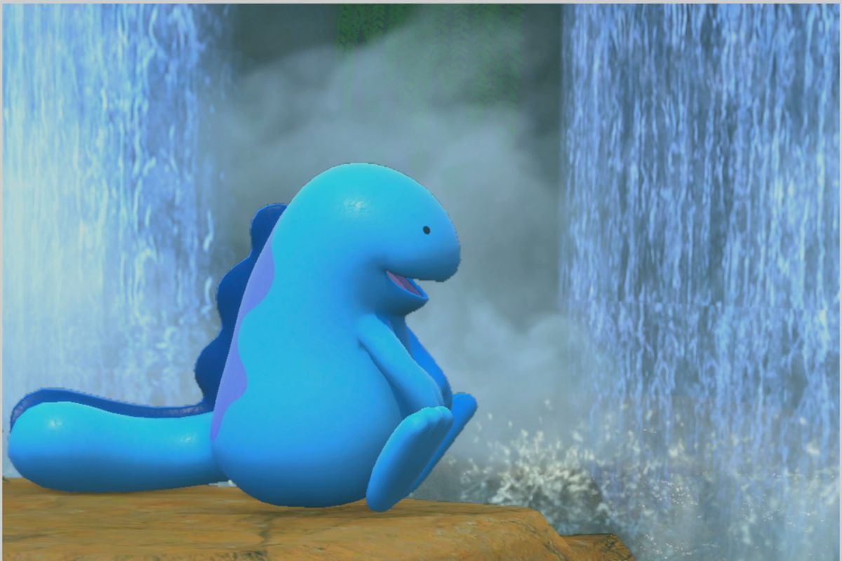 A Quagsire sits peacefully by some waterfalls